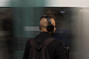 Commuter listening to a podcast for professional development